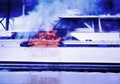 Image of boat/personal watercraft on fire.